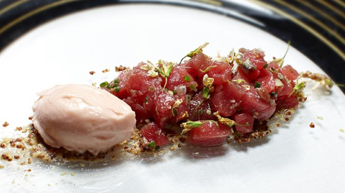 Tuna tartare on a bed of mustard and iced watermelon infusion